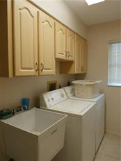 inside laundry room with utility sink - Single Family Home for sale at 416 Bahia Grande Ave, Punta Gorda, FL 33983 - MLS Number is C7408301