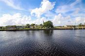 Wide canal for easy boat maneuvering- looking west for fabulous sunsets. - Single Family Home for sale at 126 Bangsberg Rd Se, Port Charlotte, FL 33952 - MLS Number is C7409866