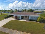 Waterfront oasis awaits you! - Single Family Home for sale at 126 Bangsberg Rd Se, Port Charlotte, FL 33952 - MLS Number is C7409866