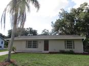 Single Family Home for sale at 925 Tropical Ave Nw, Port Charlotte, FL 33948 - MLS Number is C7417107