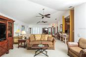 As you step back inside from the pool deck, you can see how spacious the main living area is! - Single Family Home for sale at 1633 Islamorada Blvd, Punta Gorda, FL 33955 - MLS Number is C7418555