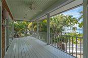 Back porch measures 25x9 - Single Family Home for sale at 124 Useppa Is, Captiva, FL 33924 - MLS Number is C7419408