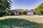 Single Family Home for sale at 7091 Quigley St, Englewood, FL 34224 - MLS Number is C7435869