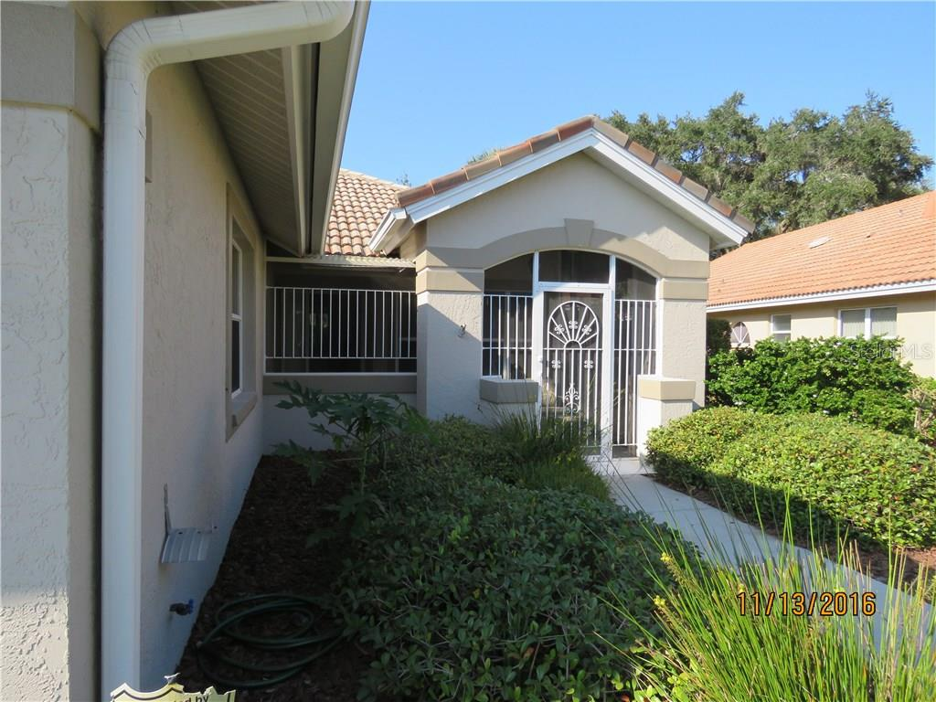 Screened in entry. - Villa for sale at 4552 Deer Trail Blvd, Sarasota, FL 34238 - MLS Number is A4161593
