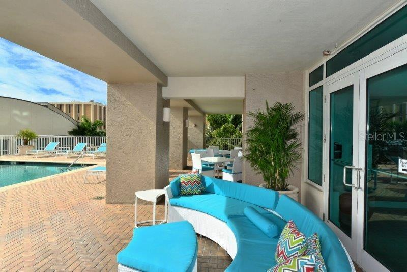 Relax by the pool featuring all new patio furniture - Condo for sale at 1771 Ringling Blvd #1108, Sarasota, FL 34236 - MLS Number is A4162718