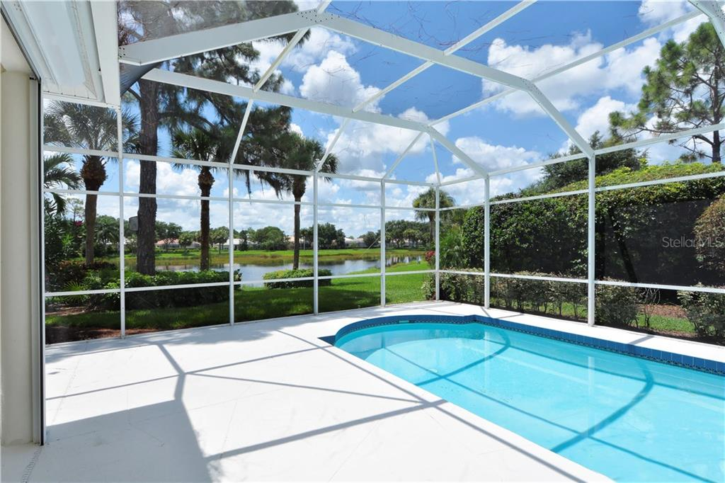 Enjoy the lush landscaping, private water view and spacious lanai with abundant under roof space for all weather entertaining. - Single Family Home for sale at 8753 Merion Ave, Sarasota, FL 34238 - MLS Number is A4165409