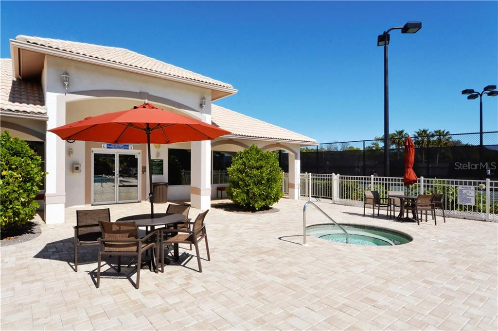 Stoneybrook Golf & Country Club Fitness Center, pool deck and spa.  Lighted Har-Tru tennis courts are to the right. - Single Family Home for sale at 8753 Merion Ave, Sarasota, FL 34238 - MLS Number is A4165409