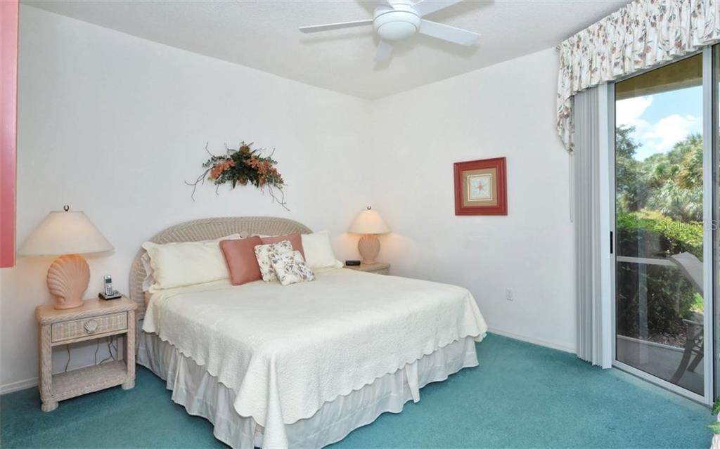 Master bedroom with sliders to lanai. - Condo for sale at 9630 Club South Cir #6103, Sarasota, FL 34238 - MLS Number is A4166105