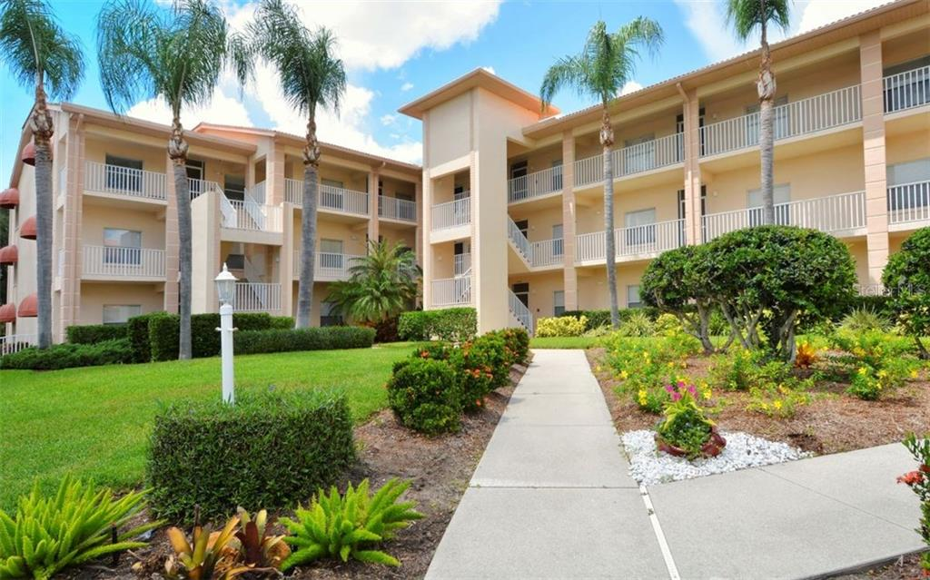 End unit condo with gorgeous views from several venues. This unit's entrance is in the far corner, adding additional privacy. - Condo for sale at 9630 Club South Cir #6103, Sarasota, FL 34238 - MLS Number is A4166105