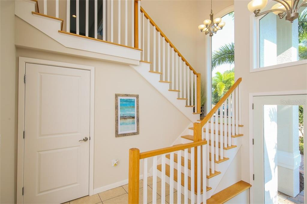 Staircase to second level - Single Family Home for sale at 827 Paradise Way, Sarasota, FL 34242 - MLS Number is A4167744