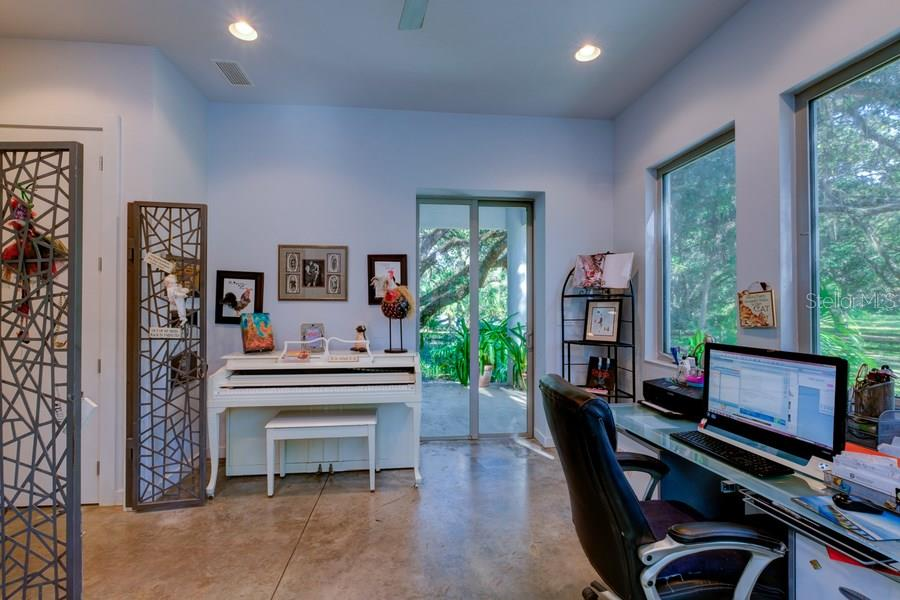 Great office/exercise  room off master with covered patio and sliders. - Single Family Home for sale at 7356 Palomino Ln, Sarasota, FL 34241 - MLS Number is A4168393