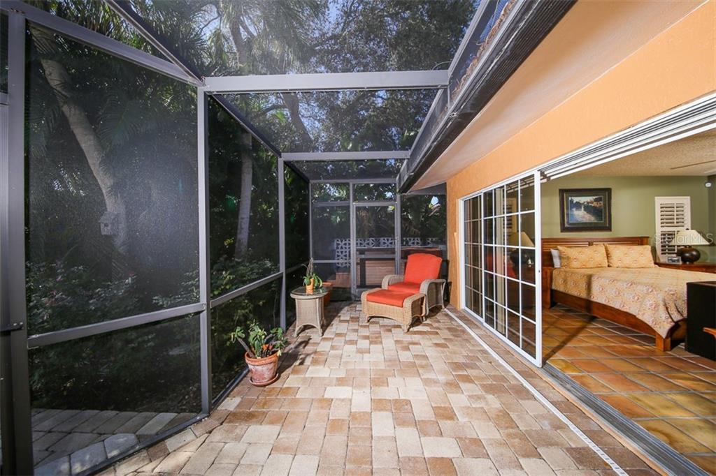 Patio access from master bedroom - Single Family Home for sale at 5281 Cape Leyte Way, Sarasota, FL 34242 - MLS Number is A4171478