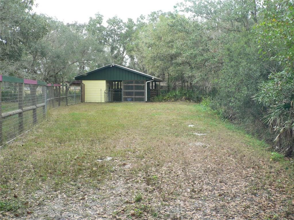 Four Stall Barn with Tack Room, Water and Electric - Single Family Home for sale at 16314 Golf Course Rd, Parrish, FL 34219 - MLS Number is A4171555