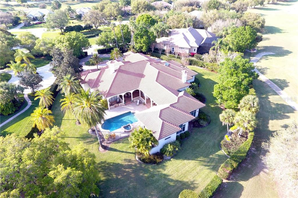 The ultimate Florida lifestyle with pool, spa, summer kitchen, multiple verandas, and even a tree house! - Single Family Home for sale at 8130 Perry Maxwell Cir, Sarasota, FL 34240 - MLS Number is A4175735