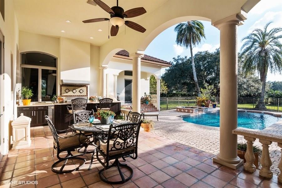 Enjoy Dining al fresco beside your full Summer Kitchen, overlooking Pool and Lawn beyond. - Single Family Home for sale at 8130 Perry Maxwell Cir, Sarasota, FL 34240 - MLS Number is A4175735