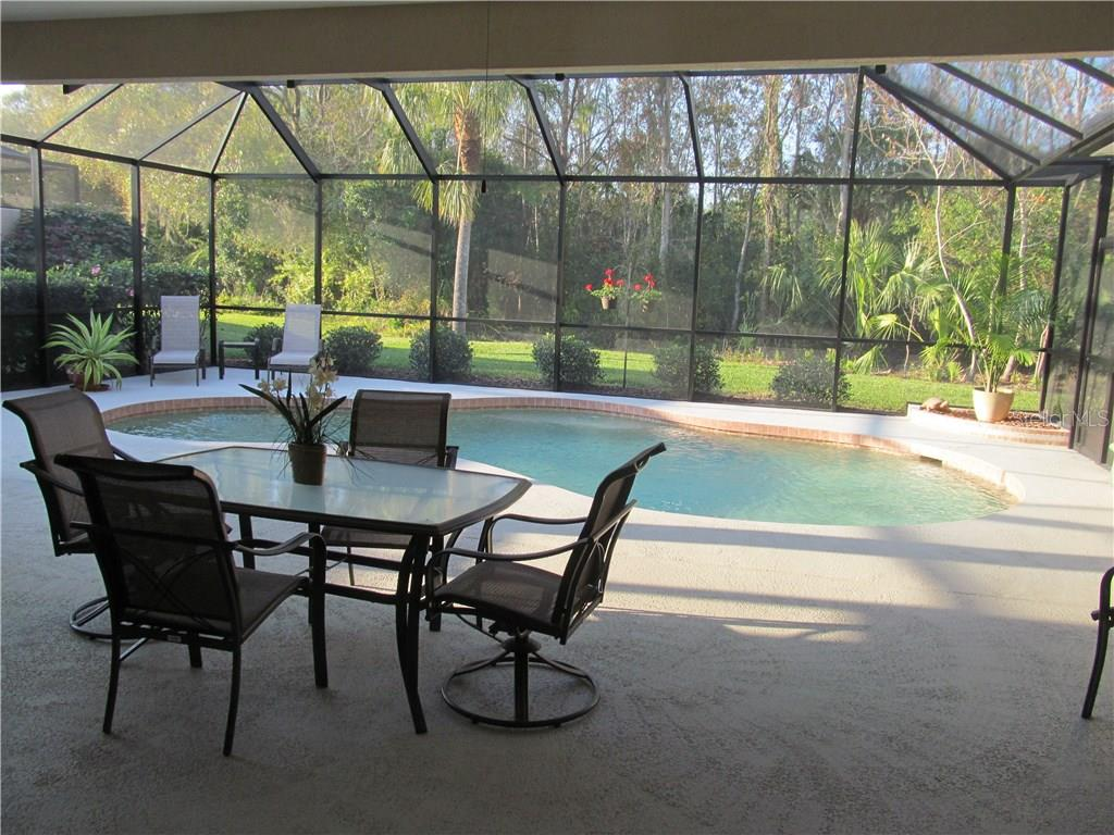 EXPANSIVE OUTDOOR LIVING TO NEWLY REFINISHED AND TILED PEBBLE CREEK 10,000 GAL POOL. - Single Family Home for sale at 7007 Chickasaw Bayou Rd, Bradenton, FL 34203 - MLS Number is A4177136