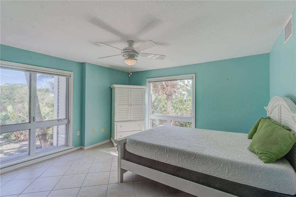 2nd Floor Guest Bedroom - Single Family Home for sale at 811 N Shore Dr, Anna Maria, FL 34216 - MLS Number is A4178184