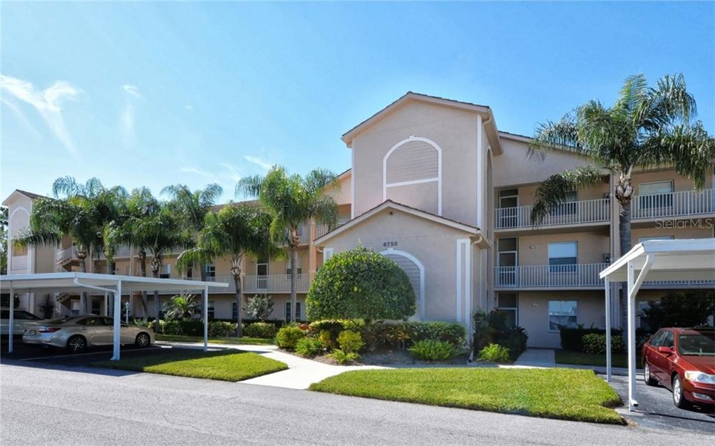 This 3rd floor unit is just steps from the elevator of The Terraces 3 Complex. - Condo for sale at 8750 Olde Hickory Ave #9305, Sarasota, FL 34238 - MLS Number is A4178271
