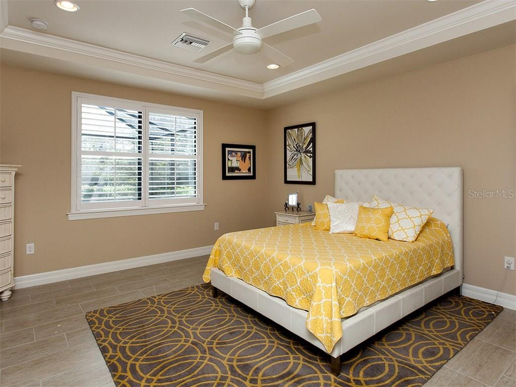Master bedroom features tray ceiling and crown molding, dual walk in closets and sumptuous master bath. - Single Family Home for sale at 5436 Sundew Dr, Sarasota, FL 34238 - MLS Number is A4178629