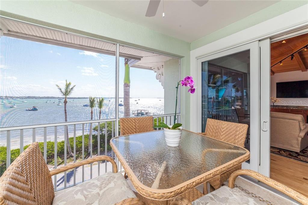 Sip on wine as you watch the Sarasota 4th of July fireworks! - Condo for sale at 318 Bay Dr S #7, Bradenton Beach, FL 34217 - MLS Number is A4178742