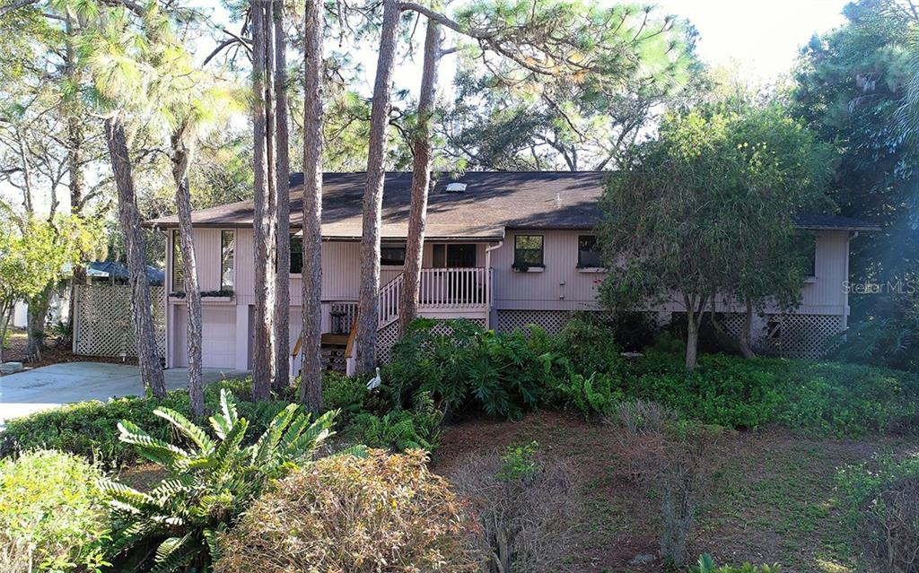 Beautiful elevated house on almost half acre - Single Family Home for sale at 1608 Hammock Dr, Nokomis, FL 34275 - MLS Number is A4178835