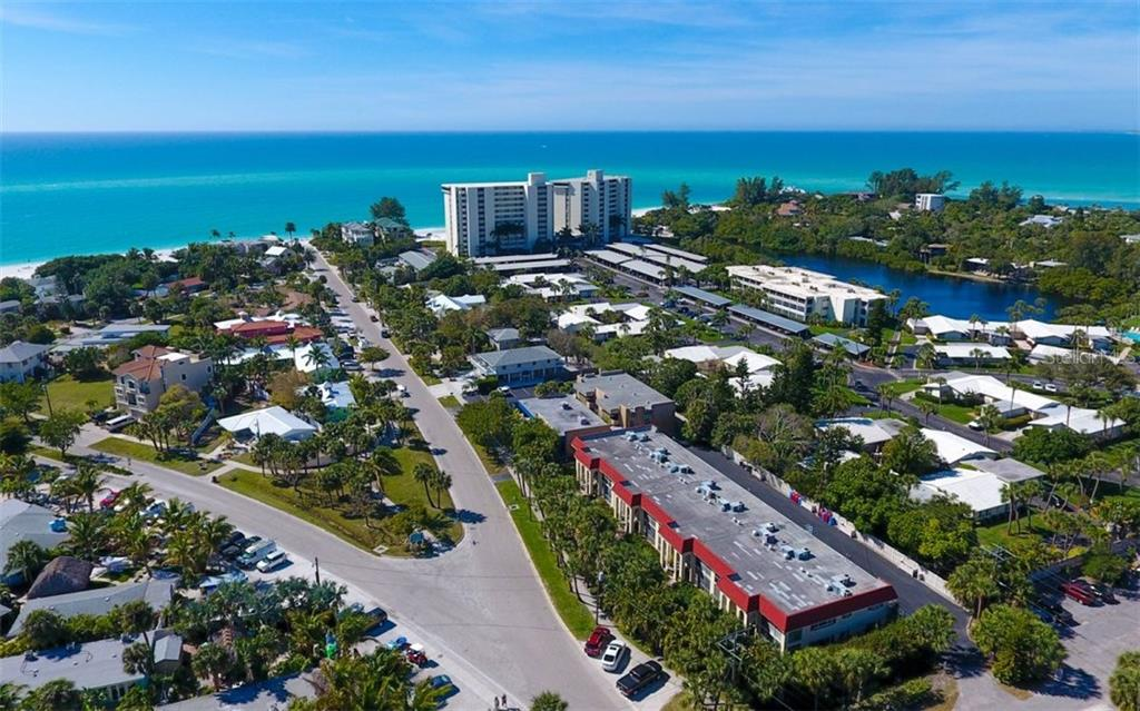 Aerial view showing proximity to north end of Siesta Key Beach - Condo for sale at 133 Avenida Messina #4, Sarasota, FL 34242 - MLS Number is A4179566