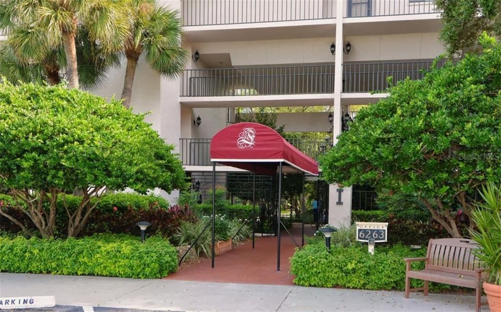 Exterior front of building - Condo for sale at 6263 Midnight Pass Rd #101, Sarasota, FL 34242 - MLS Number is A4182245