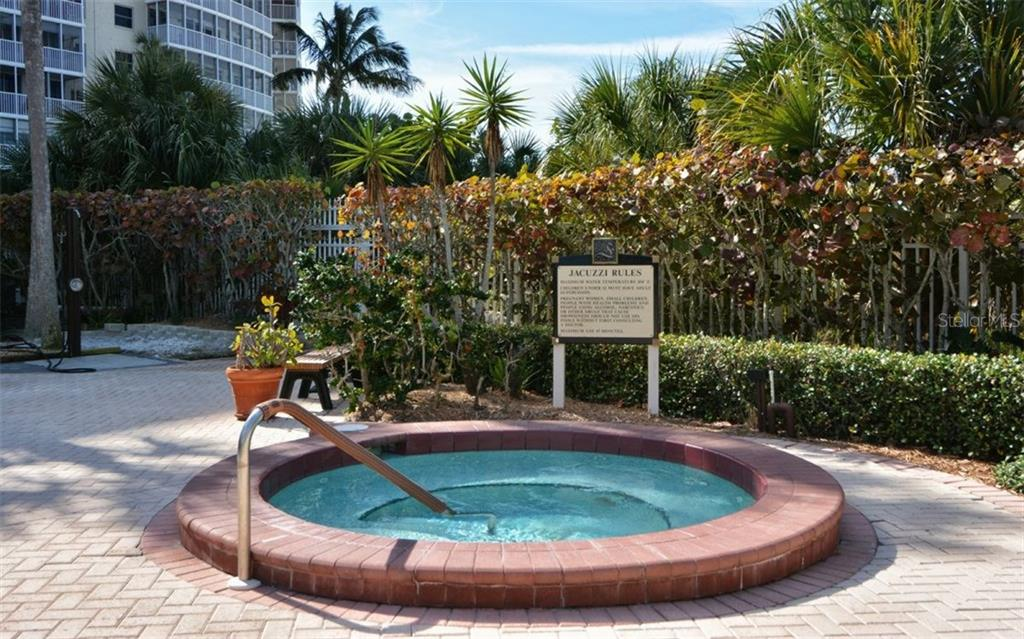 Community spa - Condo for sale at 6263 Midnight Pass Rd #101, Sarasota, FL 34242 - MLS Number is A4182245