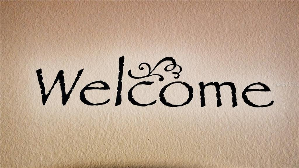 Welcome sign in home - Single Family Home for sale at 7658 Trillium Blvd, Sarasota, FL 34241 - MLS Number is A4182608