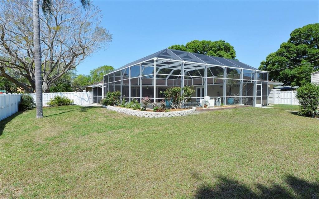 Large fenced backyard with many possibilities; boats, toys, games, gardens... your choice! - Single Family Home for sale at 6239 Hollywood Blvd, Sarasota, FL 34231 - MLS Number is A4182790