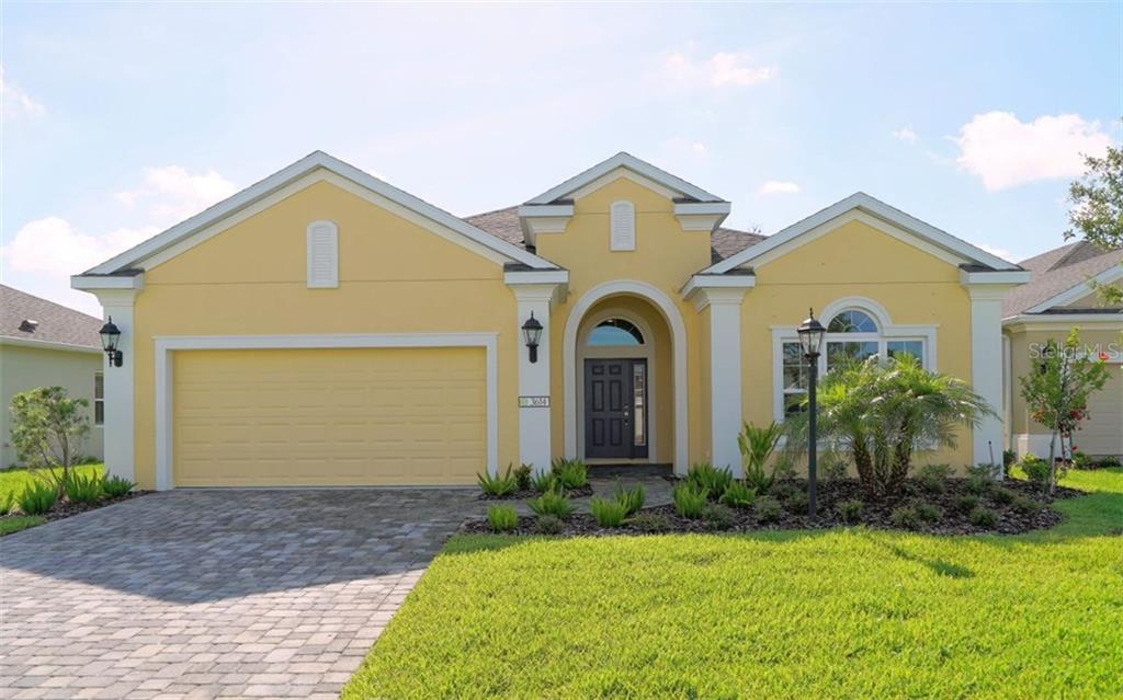 Single Family Home for sale at 3614 Woodcliff Lake Ter, Sarasota, FL 34243 - MLS Number is A4183774