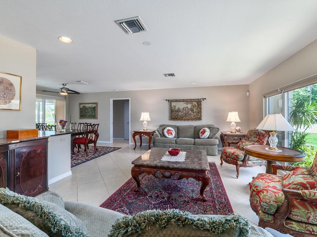 Dining room with sliders to lanai - Single Family Home for sale at 551 Putting Green Ln, Longboat Key, FL 34228 - MLS Number is A4183977