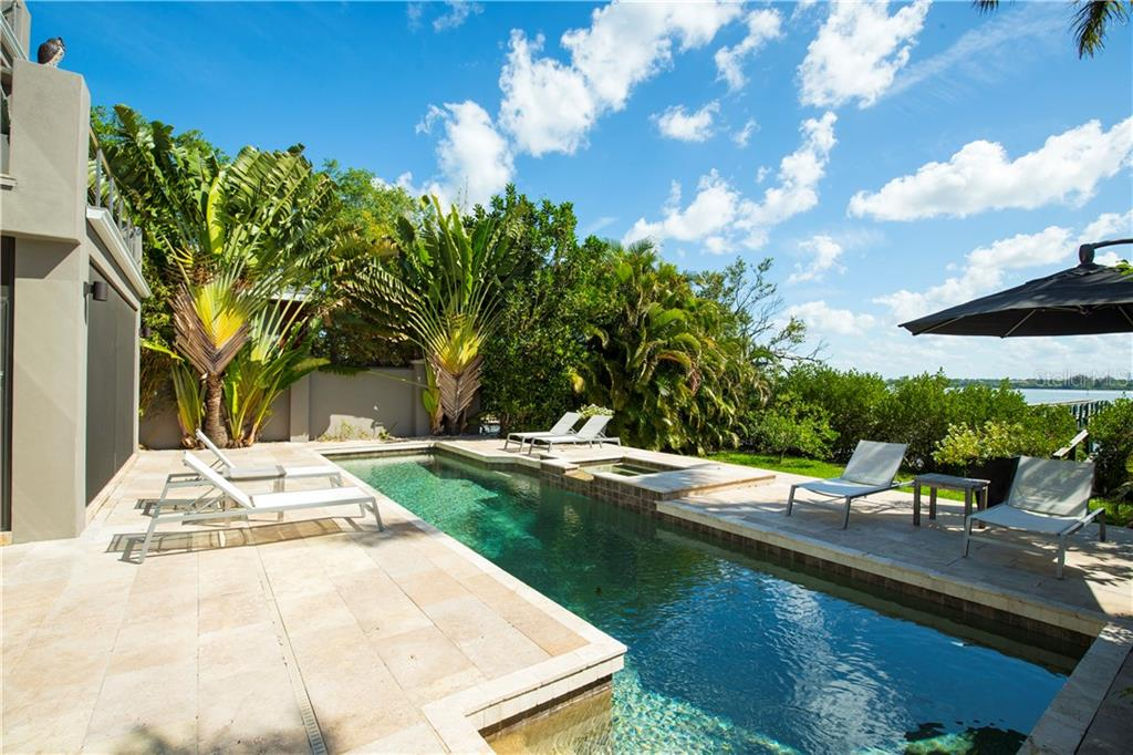 Beautiful pool & grounds. - Single Family Home for sale at 8319 Midnight Pass Rd, Sarasota, FL 34242 - MLS Number is A4184004