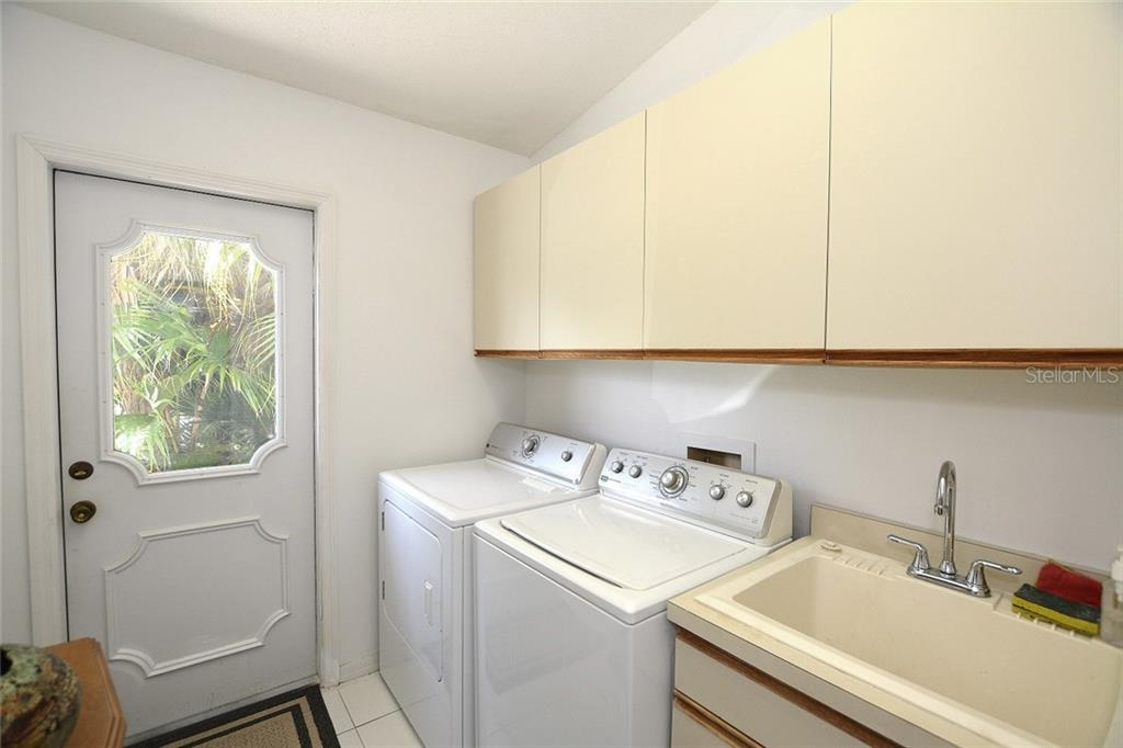 Spacious laundry room with utility sink and added storage. - Single Family Home for sale at 1157 Wyeth Dr, Nokomis, FL 34275 - MLS Number is A4185839