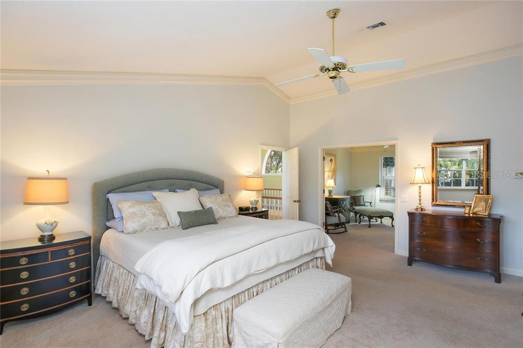 Master room suite with volume ceilings and a bonus room used as a relaxing reading room with double doors. - Single Family Home for sale at 3765 Beneva Oaks Blvd, Sarasota, FL 34238 - MLS Number is A4185879