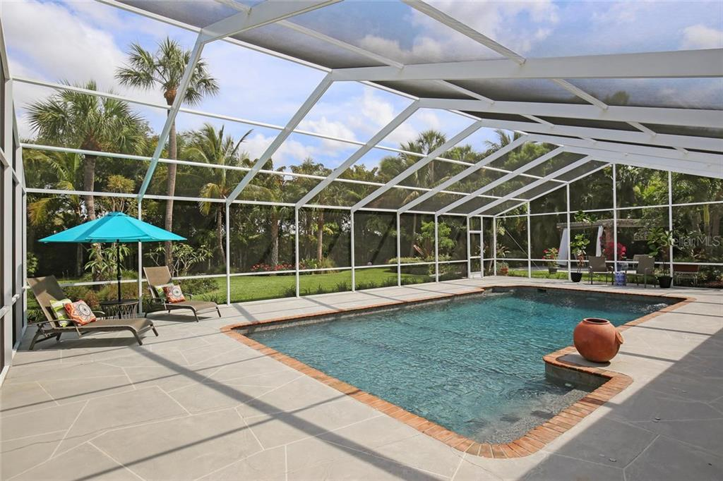 Oversized pool with ample pool deck space with a wonderful view of backyard garden. - Single Family Home for sale at 3765 Beneva Oaks Blvd, Sarasota, FL 34238 - MLS Number is A4185879