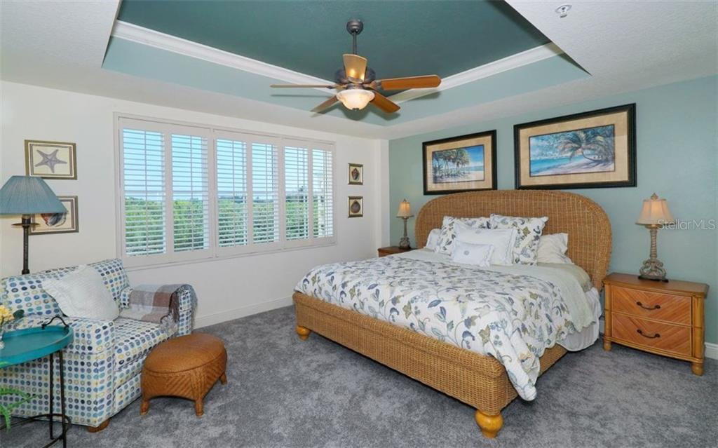 Master bedroom with tray ceiling - Condo for sale at 1310 Old Stickney Point Rd #e53, Sarasota, FL 34242 - MLS Number is A4186018