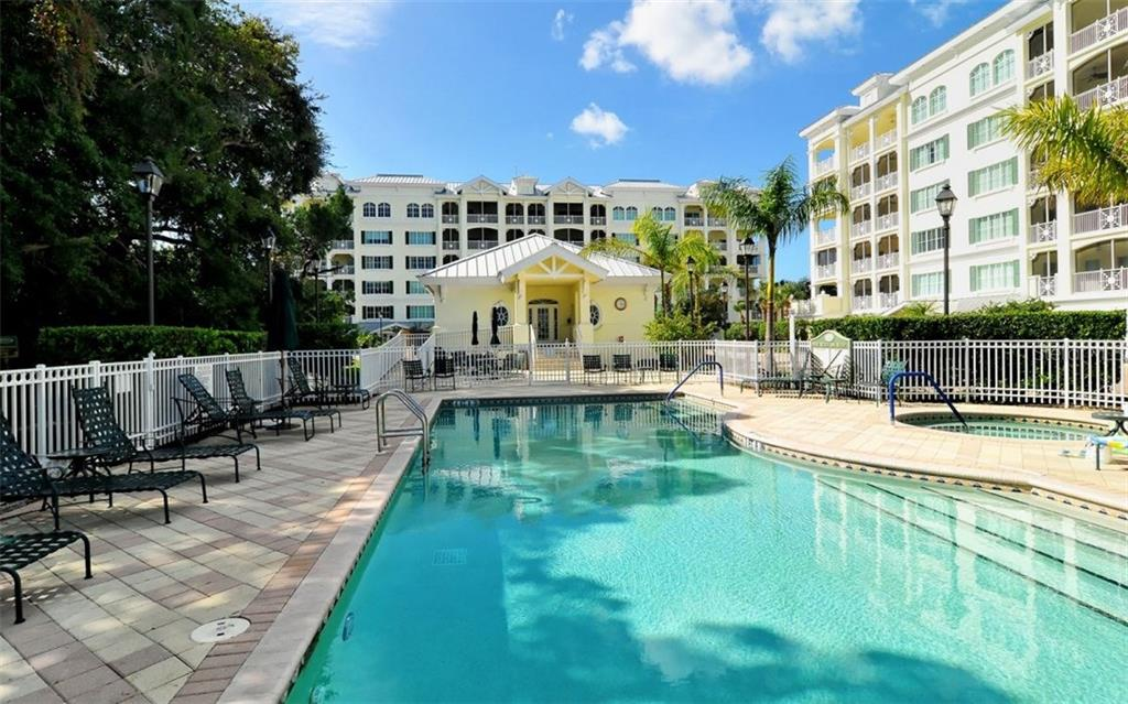 Community swimming pool, spa and paver brick sun deck - Condo for sale at 1310 Old Stickney Point Rd #e53, Sarasota, FL 34242 - MLS Number is A4186018
