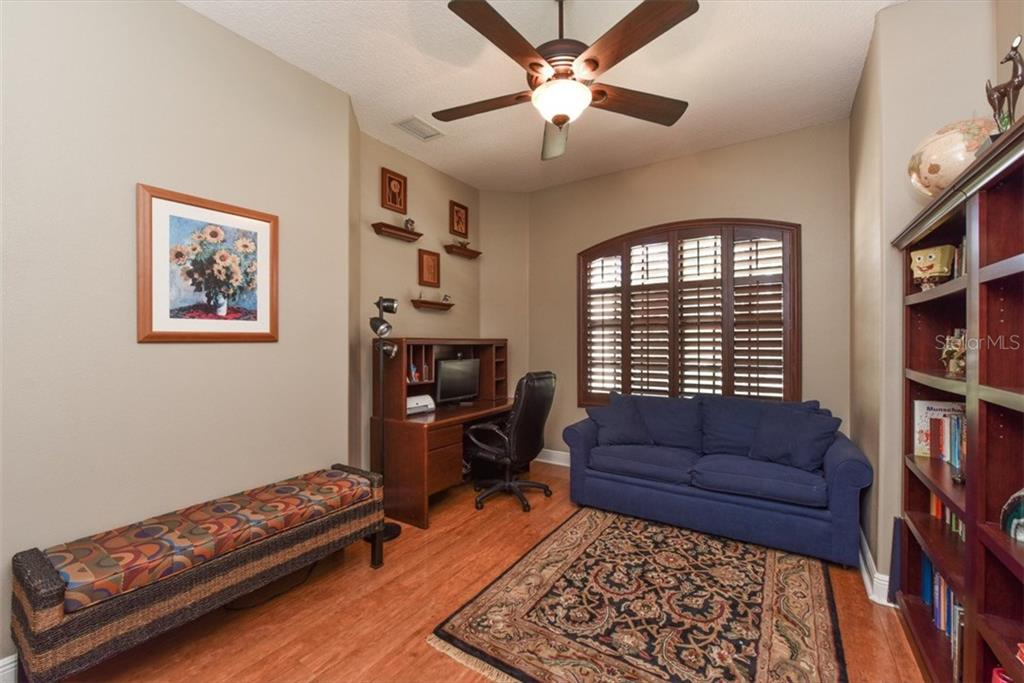 Office with wood floors and plantation shutters. - Single Family Home for sale at 4851 Sweetshade Dr, Sarasota, FL 34241 - MLS Number is A4186306