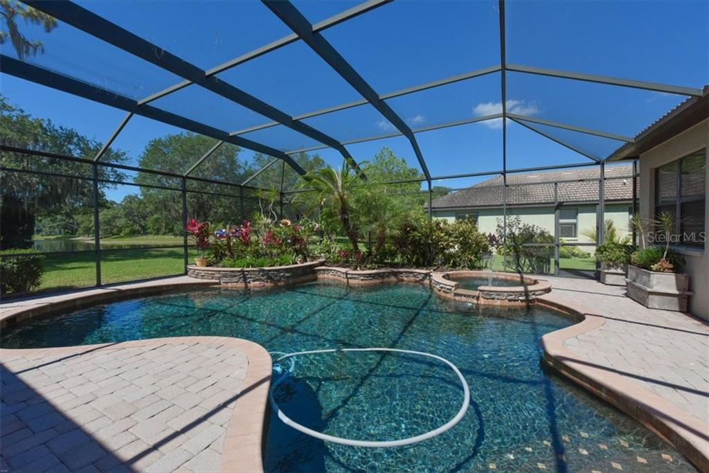 Fabulous over sized saltwater free form pool and SPA. Raided flower garden. Lovely pavers for pool deck. - Single Family Home for sale at 4851 Sweetshade Dr, Sarasota, FL 34241 - MLS Number is A4186306