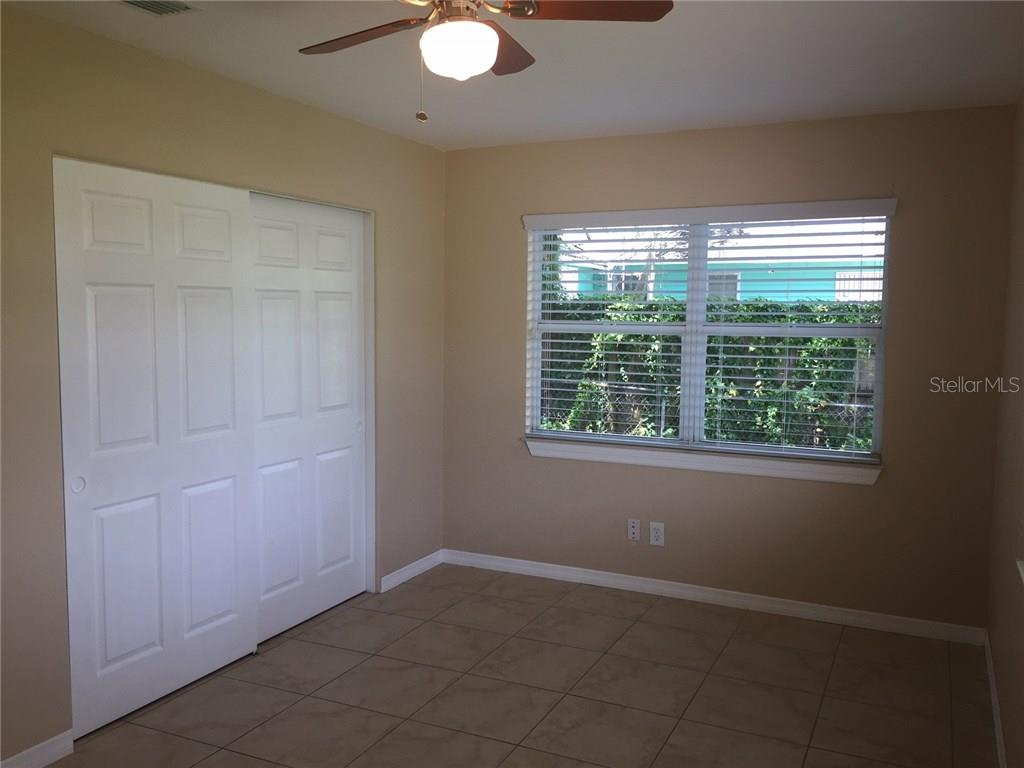 Interior freshly painted. Bedroom 1. - Single Family Home for sale at 938 Highland St, Sarasota, FL 34234 - MLS Number is A4186423