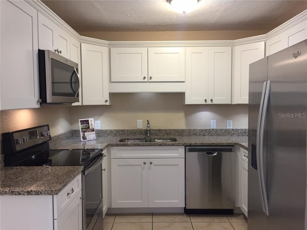 New cabinets, counter tops, sink and stainless steel appliances. - Single Family Home for sale at 938 Highland St, Sarasota, FL 34234 - MLS Number is A4186423