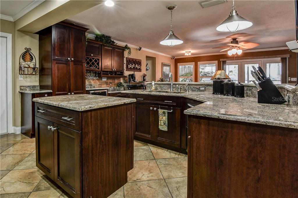 Generous kitchen storage with pantry, dry bar and built-in desk. - Single Family Home for sale at 8916 44th Avenue Dr W, Bradenton, FL 34210 - MLS Number is A4186449