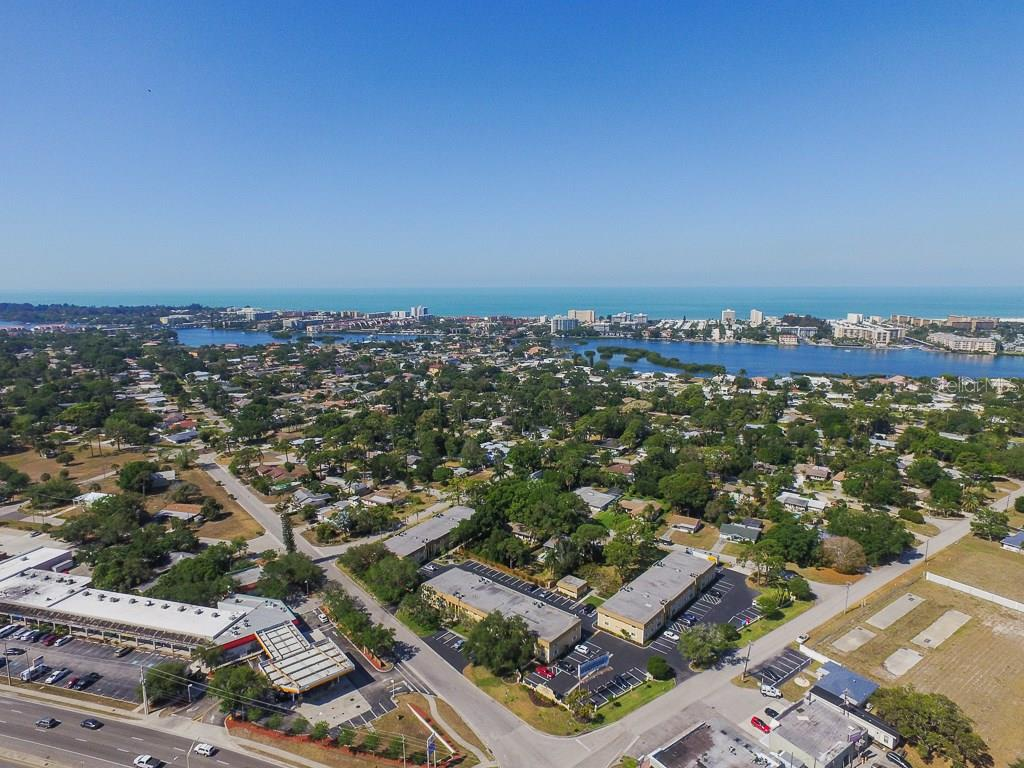 Aerial view looking southwest towards Gulf of Mexico - Condo for sale at 5800 Hollywood Blvd #113, Sarasota, FL 34231 - MLS Number is A4188016