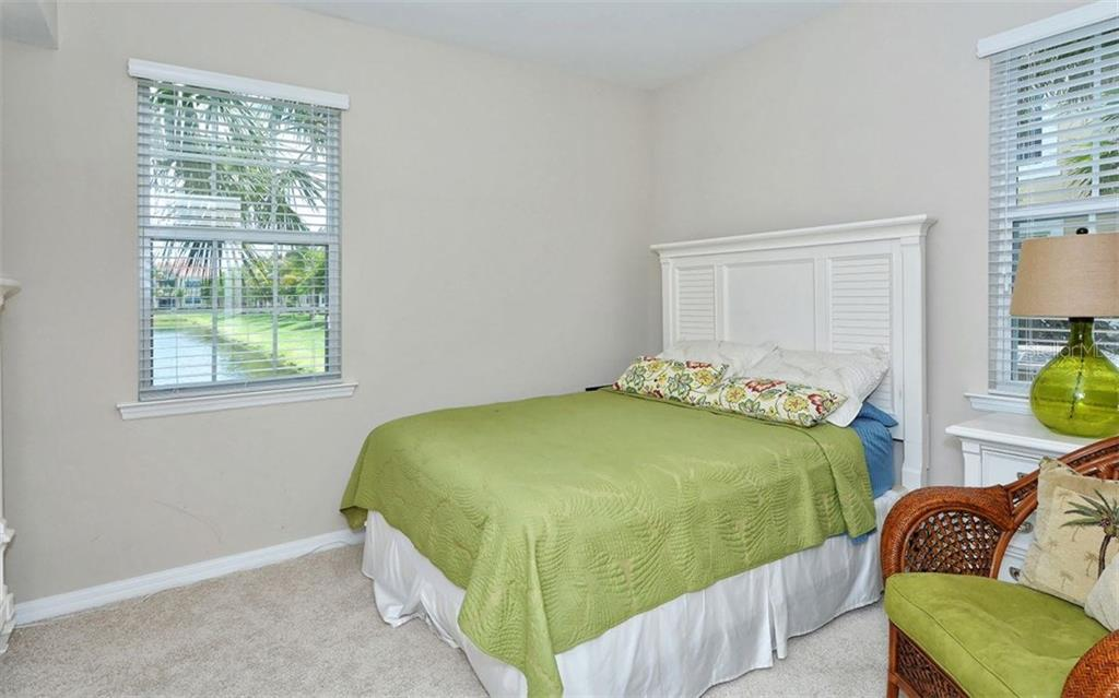 Bedroom 2 of 2 - Condo for sale at 81 Navigation Cir #103, Osprey, FL 34229 - MLS Number is A4188370