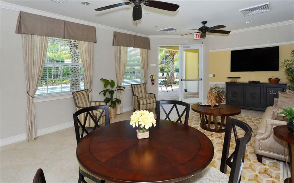 Community social room - Condo for sale at 81 Navigation Cir #103, Osprey, FL 34229 - MLS Number is A4188370