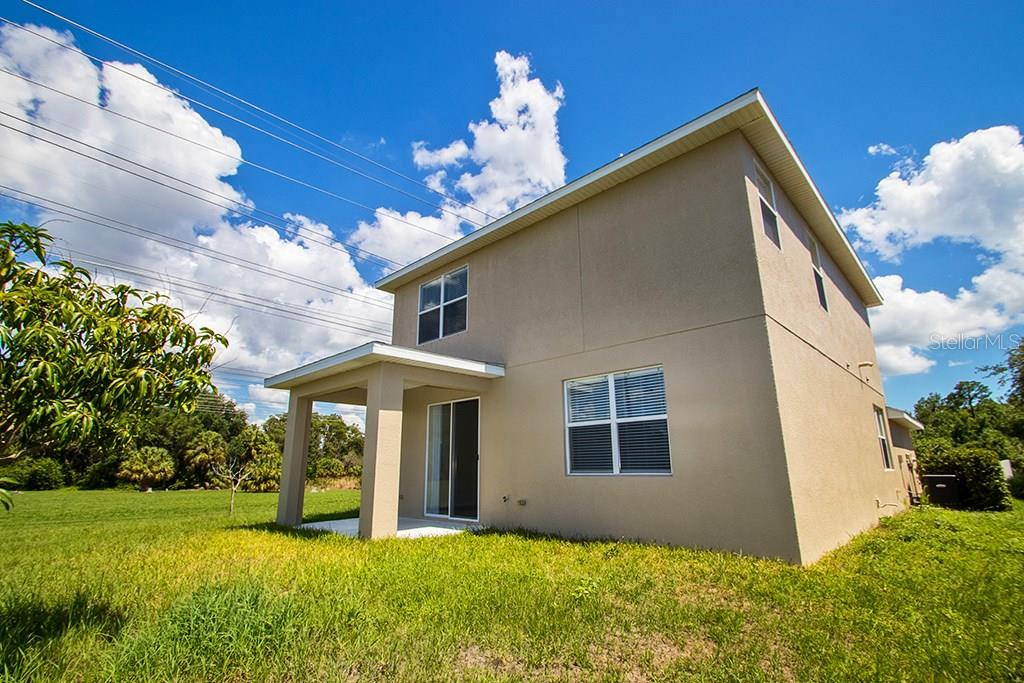 Back of house - Single Family Home for sale at 10212 37th Ct E, Parrish, FL 34219 - MLS Number is A4188756