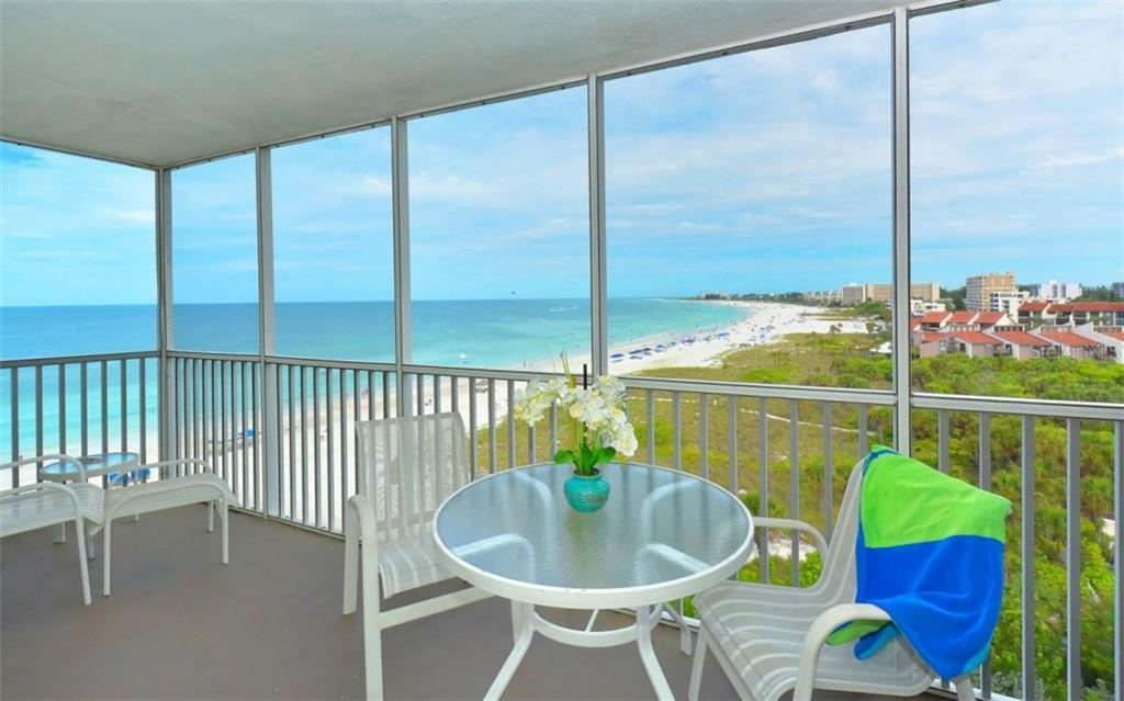 Northwest view of Siesta Key Beach from covered terrace - Condo for sale at 6300 Midnight Pass Rd #806, Sarasota, FL 34242 - MLS Number is A4189340