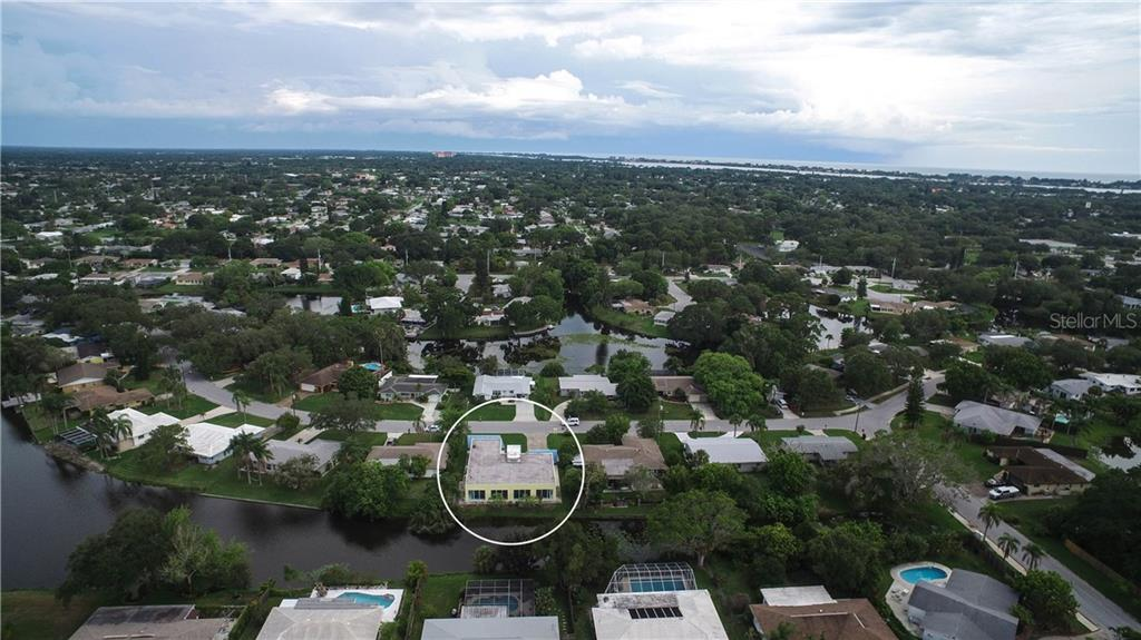 Aerial view of this waterfront pool home - Single Family Home for sale at 3319 Mayflower St, Sarasota, FL 34231 - MLS Number is A4189488