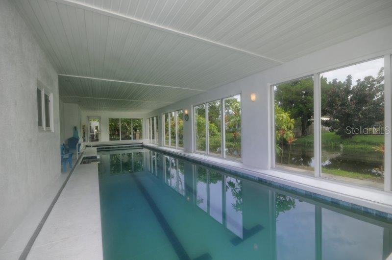 Swimming pool with lake views. Add a floating seat and read all the great books right here! - Single Family Home for sale at 3319 Mayflower St, Sarasota, FL 34231 - MLS Number is A4189488